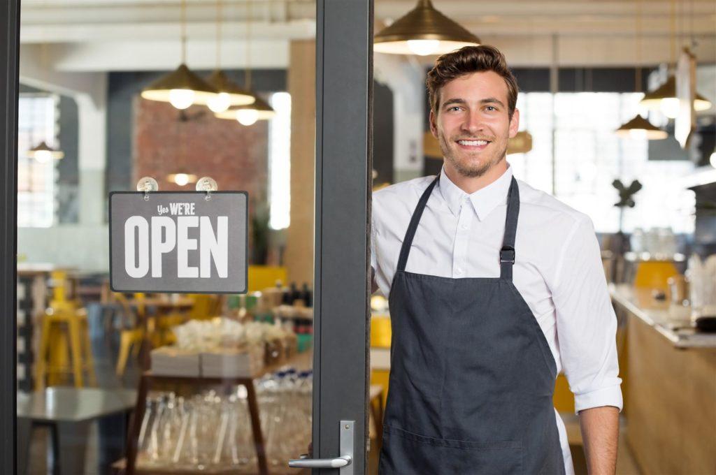 Man at restaurant door.